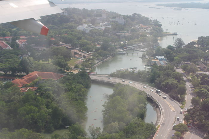 Enjoying The View Flying High In The Sky Lots Of Boats Lots Of Landscap Road And Bridge Seeing Singarpore Water Snd Trees