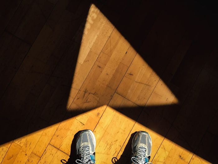 Shoe Flooring Hardwood Floor High Angle View Indoors  Low Section Real People Human Leg Standing Wooden Floor Wood - Material Lifestyles Pair Shadow Brown One Person Human Body Part Sunlight Men Day