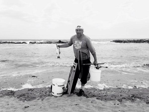 Good catch 🎣 Sofiavicchi Sofiavicchiconceptdesign Fisherman Fish Bnw Portrait Bnw_society Bnwphotography Seaside Adriatic Sea Beach Folks People Photography