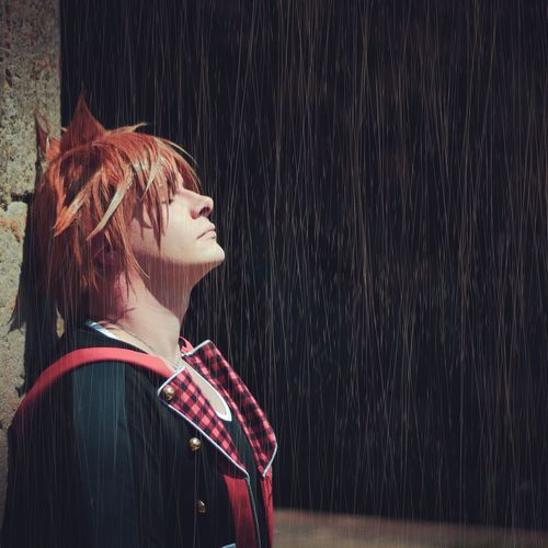 Portrait of young woman in rain