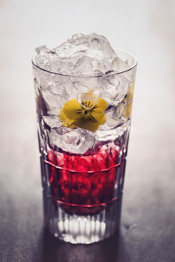 Hibiscusdrink Afterwork Yellow Flower Alcohol Close-up Cocktail Day Drink Drinking Glass Flower Freshness Ice Cube Indoors  No People Petal Red Refreshment Shot