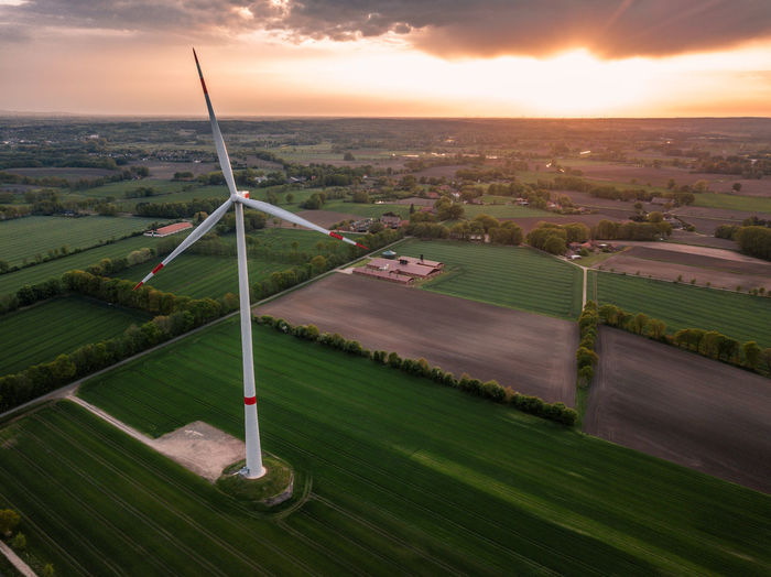 Drone  Nature Sunlight Agriculture Beauty In Nature Cloud - Sky Environment Field Green Color High Angle View Land Landscape Nature No People Outdoors Plant Rural Scene Scenics - Nature Sky Sun Sunset Tranquility Warm Windpower Windturbine