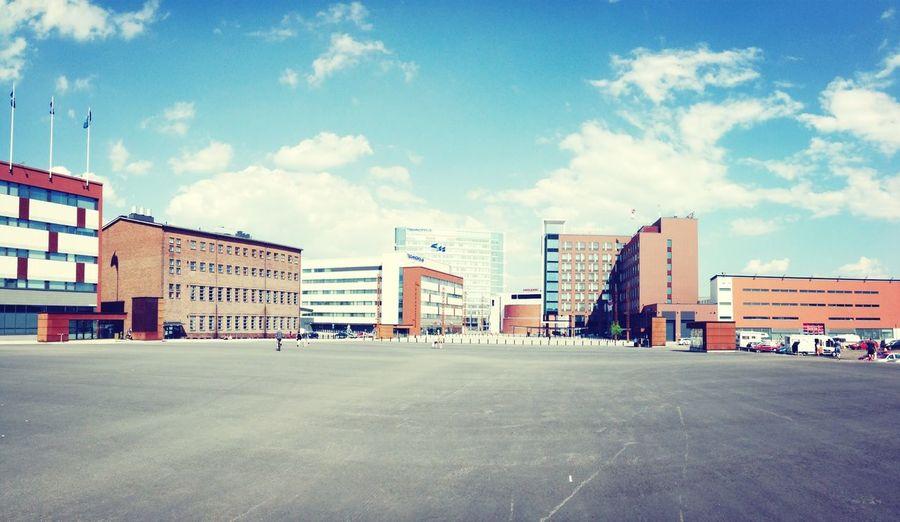 Empty Road In Front Of Buildings