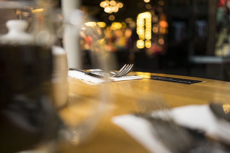 Fork And Butter Knife On Table At Restaurant