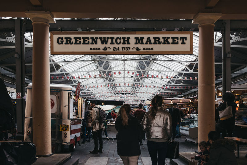People entering Greenwich Market, London's only market set within a World Heritage Site. Market Greenwich Market Greenwich Uk London Sign Entrance Namibia Group Of People Real People Architecture Lifestyles Travel Crowd Rear View People Leisure Activity City Walking Day Architectural Column Ceiling Built Structure Indoors  Men Women Group Adult Text