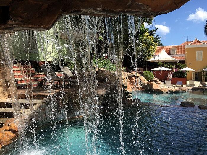 Behind the waterfall at Kura Hulanda Hotel, Willemstad, Curaçao Adults Only Architecture Building Exterior Curacao Curacao (willemstad) Day Hotel Garden Kura Hulanda Leisure Activity Lifestyles Outdoors Pool Waterfall Swimming Pool Vacations Water