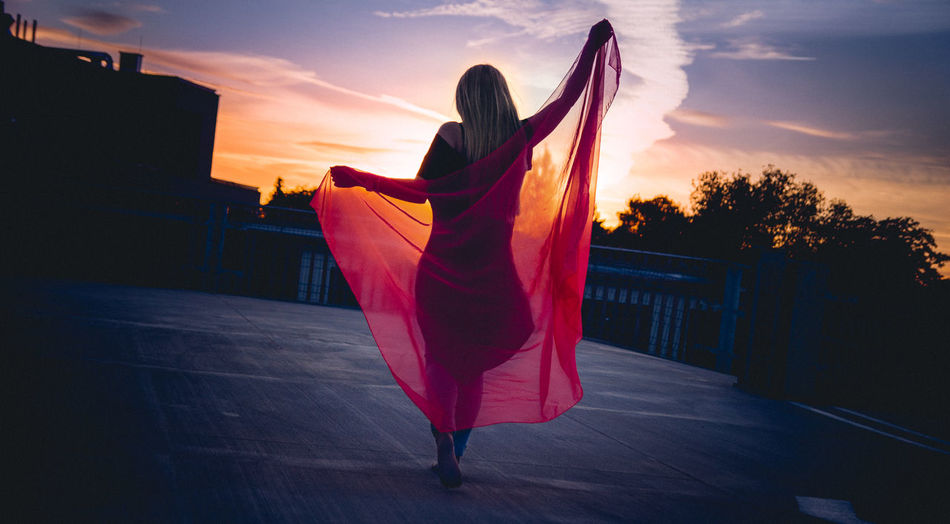 summer Casual Clothing Evening Evening Sky Freedom Leisure Activity Lifestyles Orange Color Person Sky Standing Sunset Young Women