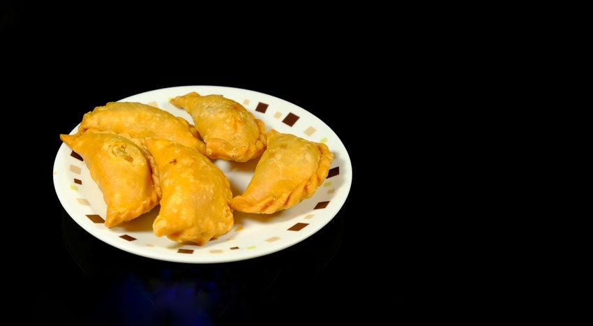 Malaysian Curry puff popularly known as Karipap in Malaysia Karipap Currypuff Epok Epok Ramadan Bazar Asian Snacks Anyone? Black Background Paper Plate Plate Sweet Pie Close-up Food And Drink Deep Fried  Croissant Prepared Potato