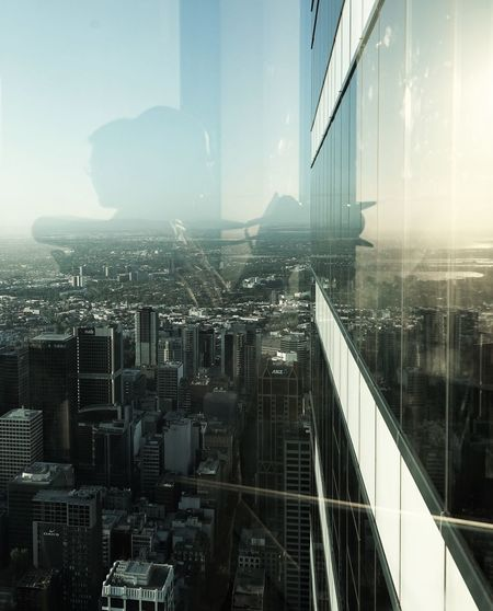 Cityscape EyeEmNewHere Glasses Buildings Highrise Highrisebuilding Horizon Metropolitan Oppsite Reflections Two Directions Two People Two Views Vertical