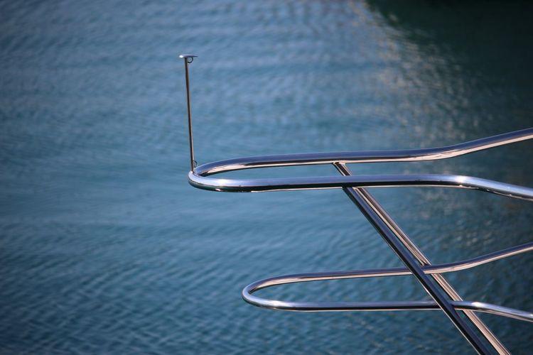 Close-Up Of Boat Railing On Sea