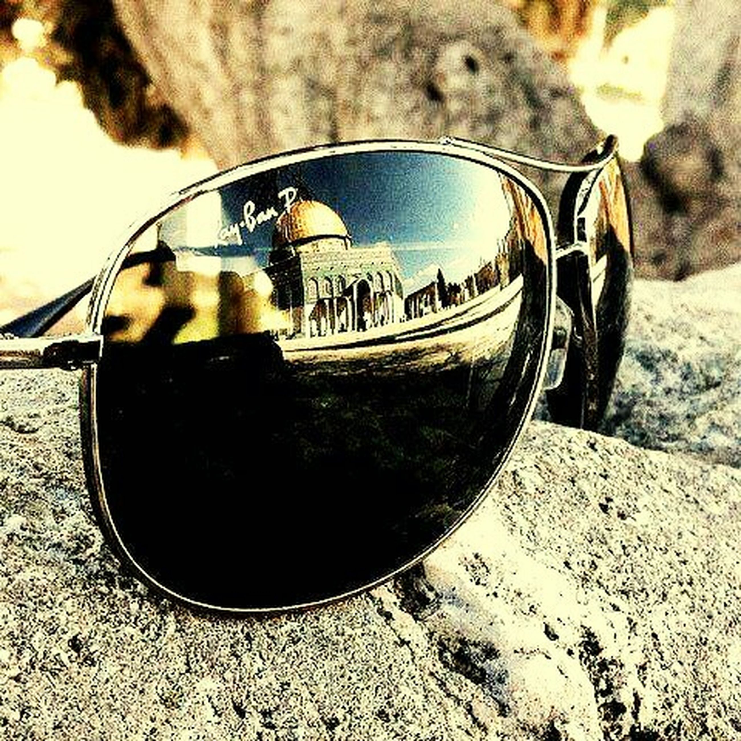 transportation, sunglasses, beach, sky, close-up, mode of transport, wheel, part of, sand, sunlight, outdoors, land vehicle, reflection, focus on foreground, day, cropped, tire, bicycle