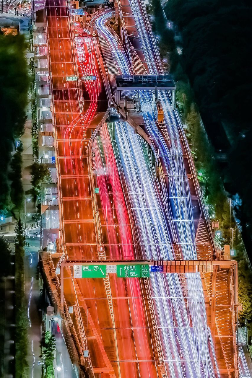 illuminated, motion, long exposure, architecture, night, multi colored, blurred motion, light trail, speed, built structure, building exterior, city, no people, outdoors, reflection, glowing, nature, travel destinations, low angle view, building, digital composite