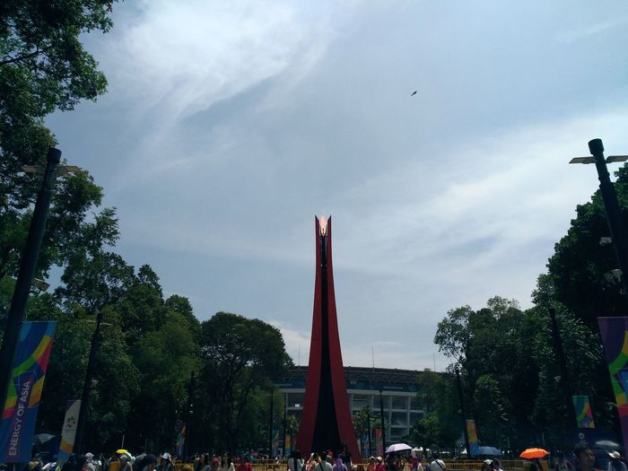 Gelora Bung Karno GBK City Street Cityscape City View  Urban Exploration Street Life Asian Games Asian Games 2018 Energy Of Asia Street Photography Perspective Sport Cauldron Torch Tree City Statue Sky Architecture Cloud - Sky Built Structure National Flag Historic Memorial