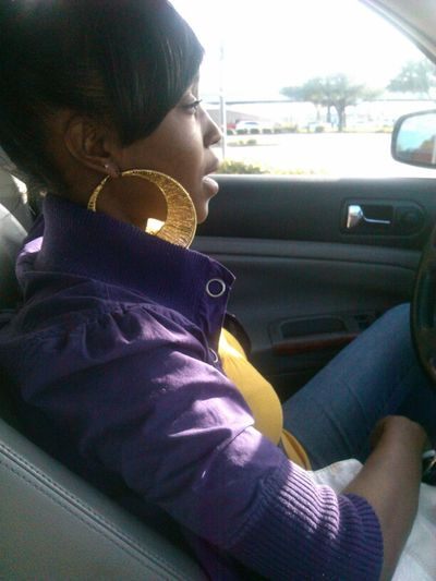 my Tladyy wearing her Baltimore ravens colors:)