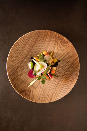High angle view of flowers in plate on table