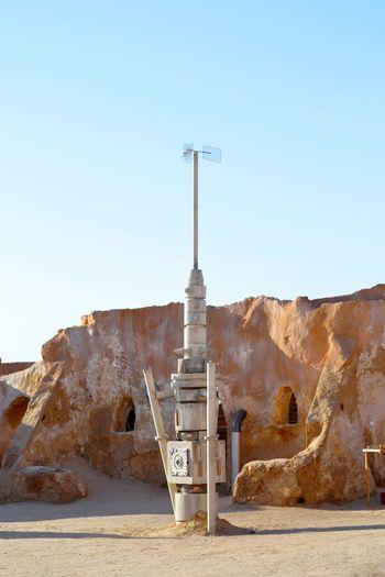 Built structure on desert against clear sky