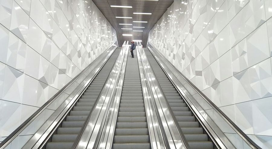 Symmetry Escalator Going Up White Background White Facade Pattern Pieces Your Design Story Train Station Design White Wall Silver  Handrail  Stairs Symmetrical Architecture Architectural Detail On My Way Man Passing By Underground Tube Station  Modern Art Minimalism The Architect - 2016 EyeEm Awards Passenger Three Escalator My Commute Stories From The City