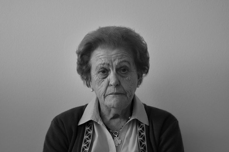 The Portraitist - 2017 EyeEm Awards Senior Adult Front View Wrinkled One Person Looking At Camera Portrait Real People Headshot Senior Women Studio Shot Casual Clothing Lifestyles Indoors  White Background Close-up Day Adult People The Portraitist - 2017 EyeEm Awards Black And White Friday Inner Power This Is Aging