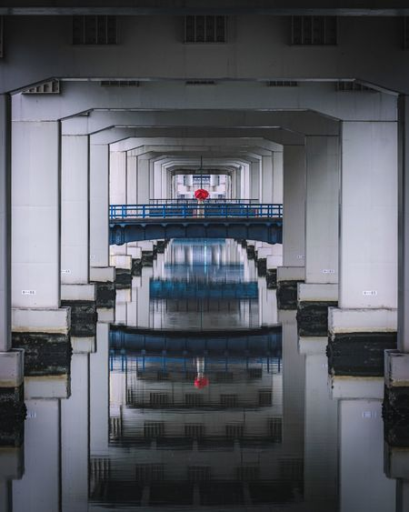 Underneath view of bridge with reflection