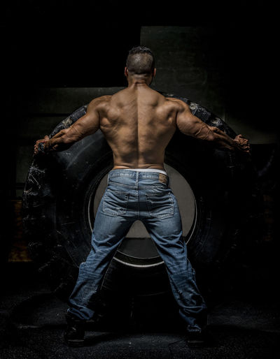Body Builder Exercising With Heavy Tire