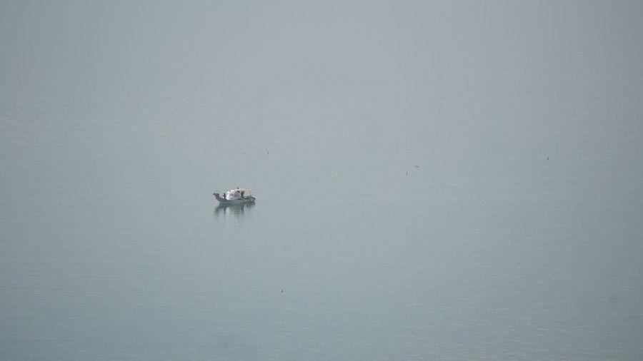 Boat sailing in sea