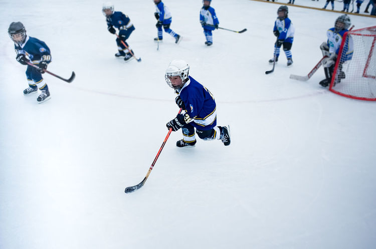 Hockey Kids Adult Athlete Competition Competitive Sport Day Headwear Helmet Hockey Ice Ice Hockey Ice Hockey Stick Ice Rink Ice Skate Ice-skating Indoors  Motion People Playing Skill  Sport Sports Helmet Stadium Winter Winter Sport Shades Of Winter