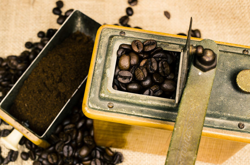 Close-up high angle view of coffee grinder on table