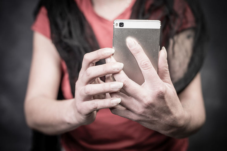 using phone Social Media Making Selfies Online Shopping  Online  EyeEm Selects Wireless Technology Portable Information Device Smart Phone Mobile Phone Photographing Photography Themes Communication Photo Messaging Connection Technology Telephone Selfie One Person Holding Human Hand