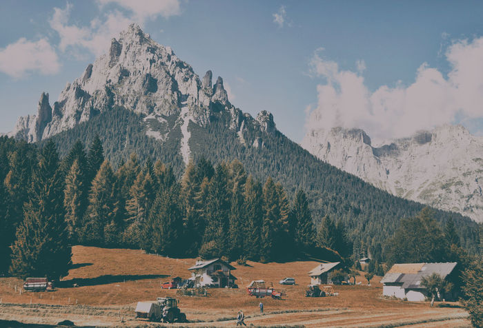 Harvesting of hay in the mountains Beauty In Nature Cloud - Sky Dolomiti Environment Land Landscape Meadow Mountain Mountain Range Nature Outdoors Scenics - Nature Sky Tranquil Scene Tranquility Tree Village My Best Travel Photo