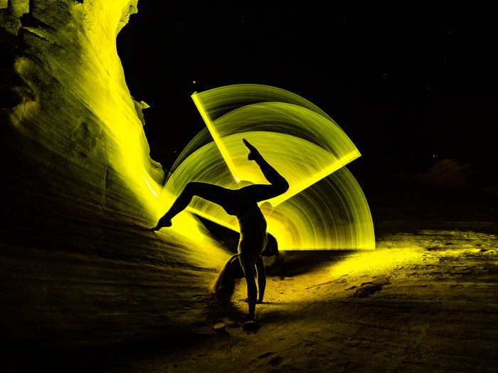 Man with umbrella standing at night