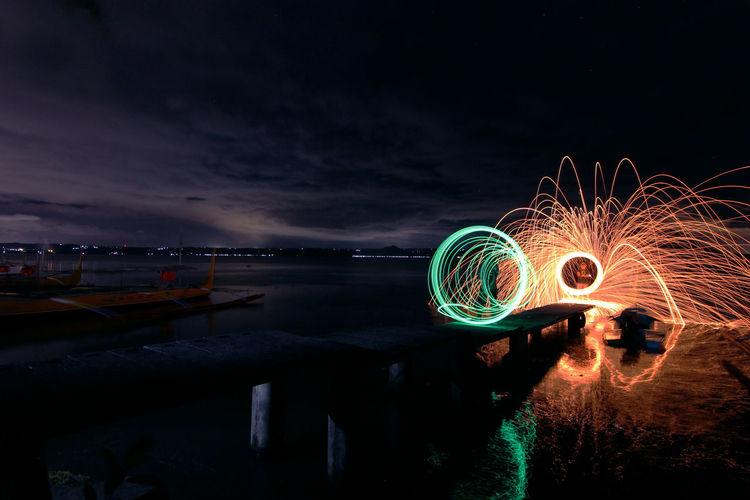 Light paintings at beach at night