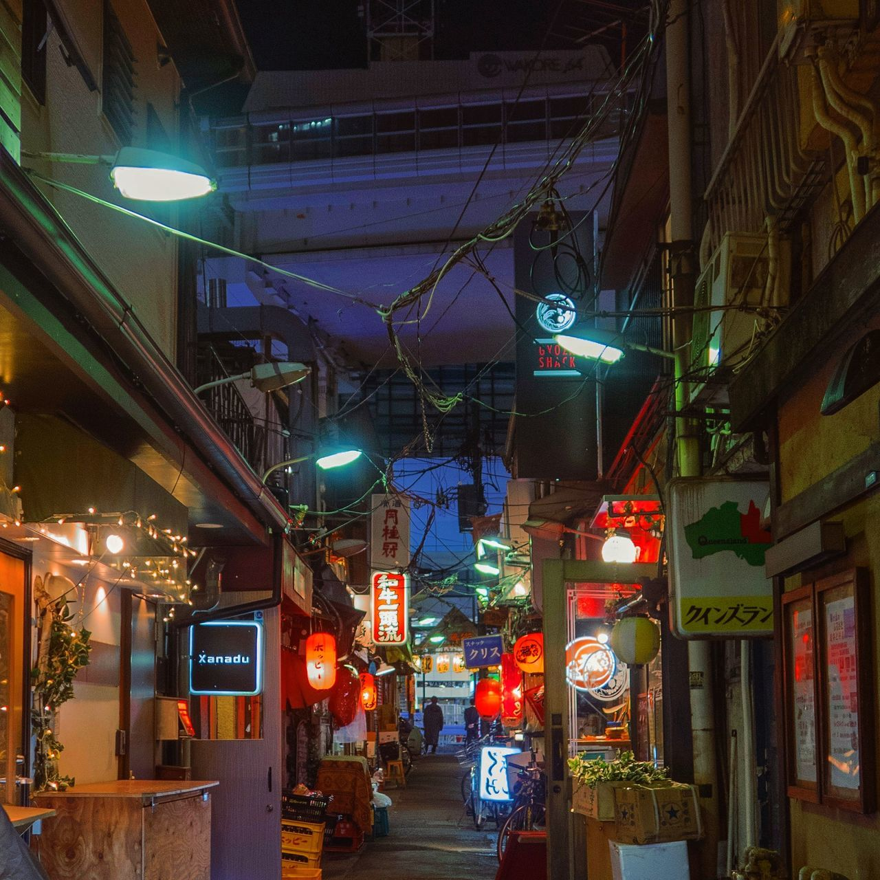 illuminated, night, lighting equipment, architecture, built structure, building exterior, city, street, glowing, store, hanging, no people, building, street light, communication, retail, electricity, decoration, light, ceiling
