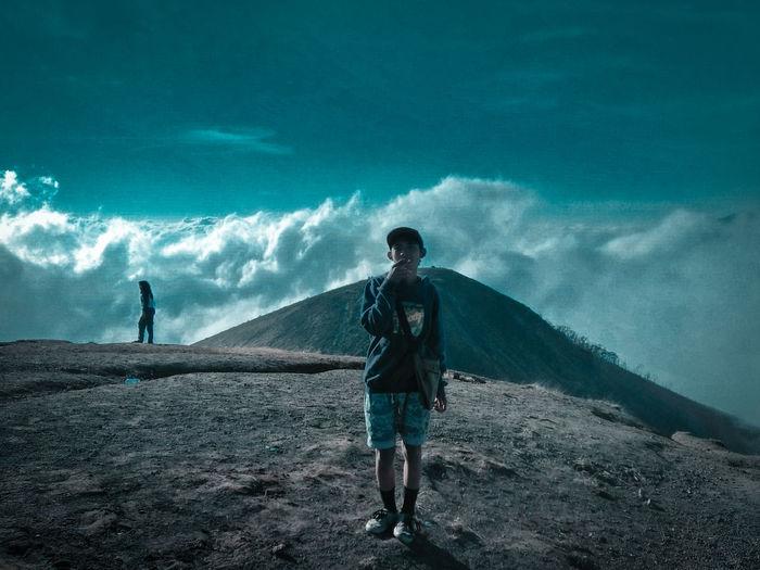 Full length of man standing on sea shore against sky