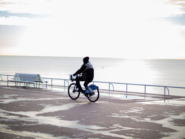 Bicycle Calm Cycling Day Escapism Full Length Horizon Over Water Land Vehicle Long Men Mode Of Transport Nature Outdoors Promenade Railing Relaxation Remote Sea Sky Solitude Tranquil Scene Tranquility Transportation Water
