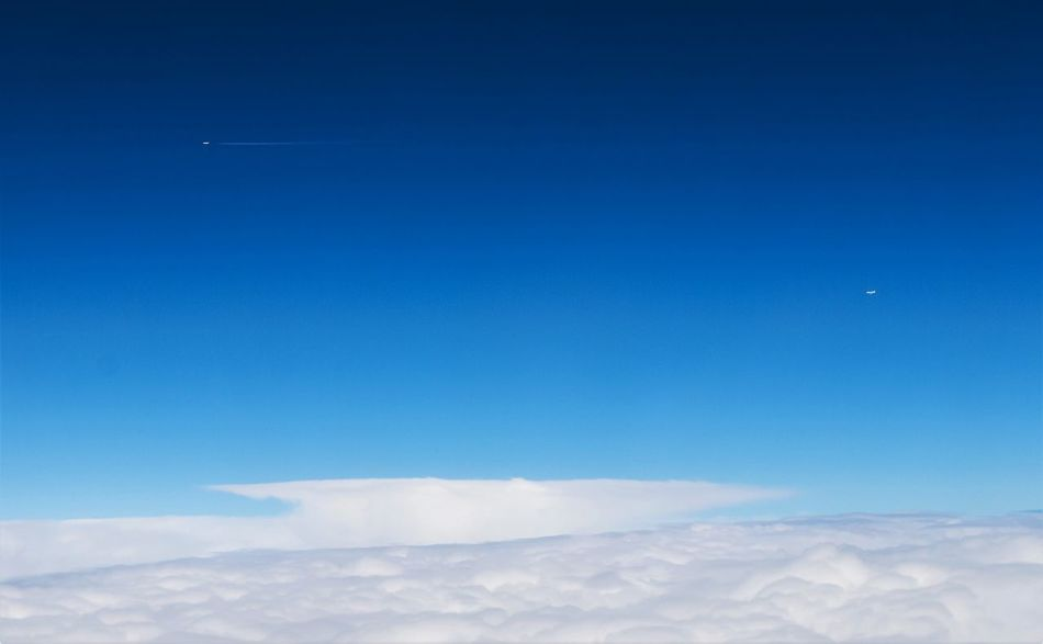 Parallel flight/ from an airplane/ Low angle view/ Sky/ blue In Parallel Low Angle View Parallel Flight Speeding The Week On EyeEm Blue Blue Sky Day From An Airplane Window No People Sky Speed Speed Limit Speed Limit Sign Vapor Trail