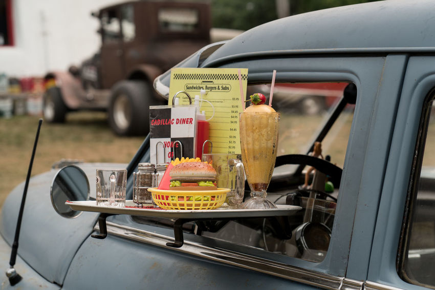 1960's Car Close-up Diner Drive-in Focus On Foreground Food And Drink Mode Of Transportation Motor Vehicle No People Sign Transportation Vintage Cars