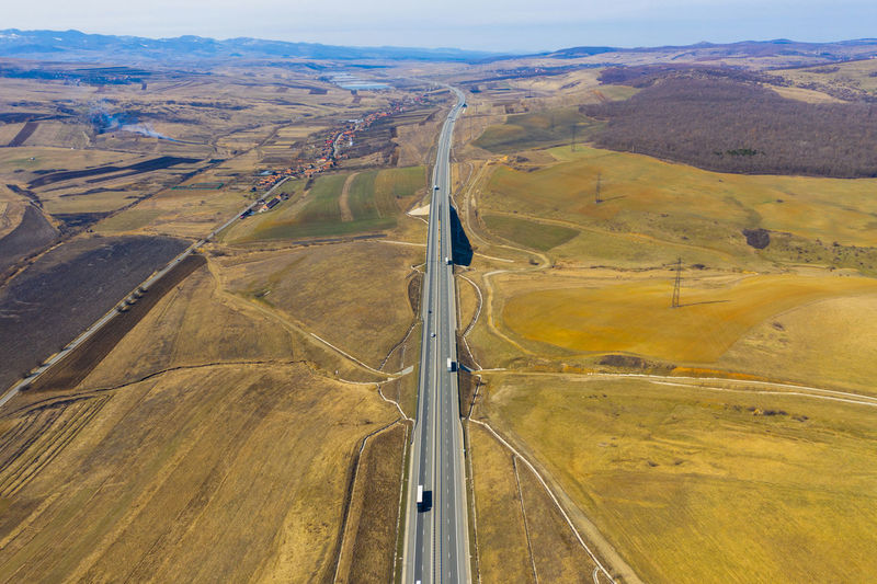 Aerial top view of cars and trucks passing on a highway, drone shot Transportation Day High Angle View Nature No People Outdoors Road Highway Cars Trucks Highways&Freeways Transportation Roadtrip Aerial View Aerial Aerial Photography Aerial Shot Aerial Landscape Drone  Dronephotography Droneshot Travel Journey Romania Above View