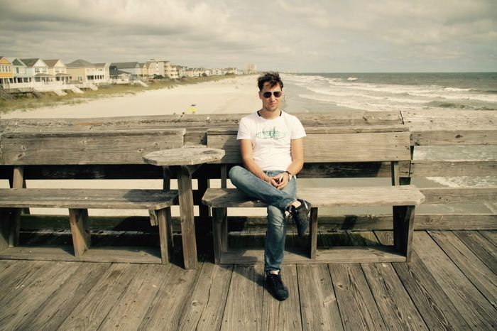 Man Ocean View South Carolina Summertime Surfside Beach Vacation Time Vacations America Bench Casual Clothing Front View Full Length Leisure Activity Lifestyles Ocean One Person Outdoors Portrait Real People Sea Seat Sitting Summer Young Adult Young Men Adventures In The City My Best Travel Photo