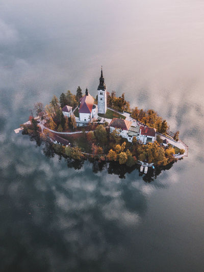 Lake Bled Lake Outdoors No People Sky Built Structure Nature Nature_collection Nature Photography Naturelovers Dramatic Sky Drone  Dronephotography Outdoor Photography Water Waterfront Spirituality Sky And Clouds Skyporn Tree Slovenia Architecture Religion Place Of Worship Fog Nautical Vessel