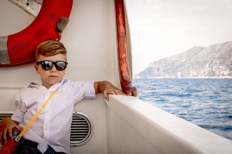 Small boy cruising on passenger ship on summer vacation.