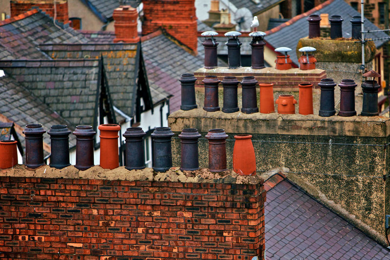 High Angle View Of Chimneys On Roofs