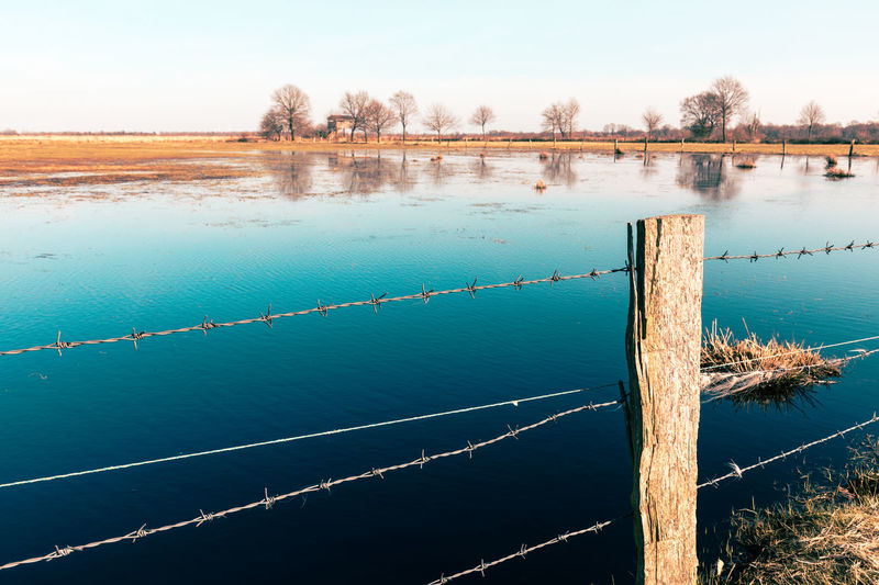 Fence Moor  Flood Nature Swamp Blue Water Grass Trees Sky Natural Lake High Angle View Scenics - Nature