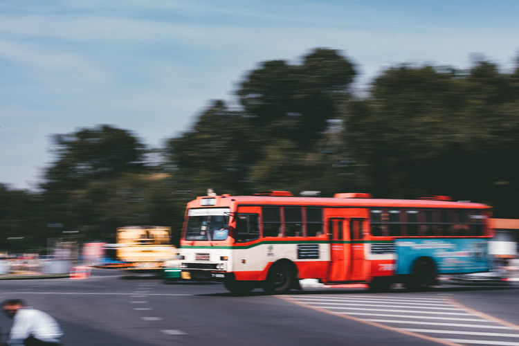 Blurred motion of vehicles on road in city