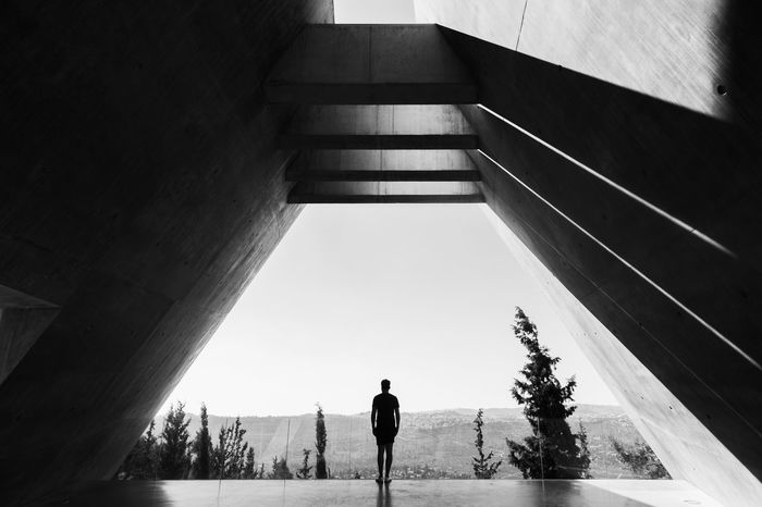 julian at yad vashem in jerusalem Architecture Black And White Built Structure Concert Concrete Lonely Person Modern Remembrance Thoughful Thought Thoughts Monochrome Photography The City Light