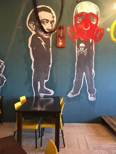Restaurant Human Representation Art And Craft Indoors  Day Full Length People Yellow Chair Dalí Gas Mask Graffiti Graffiti Art