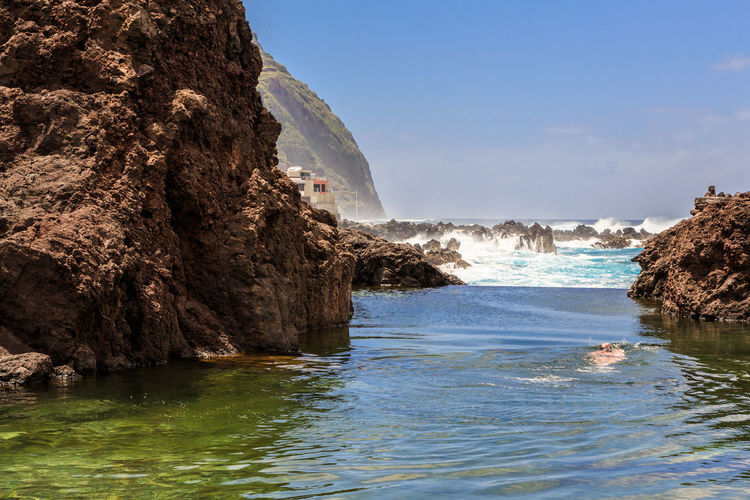 Natural Pool Water Rock Rock - Object Sea Solid Rock Formation Beauty In Nature Scenics - Nature Land Nature Motion Cliff Sky Waterfront Day Tranquility Tranquil Scene Beach Outdoors Power In Nature Eroded Swimmer