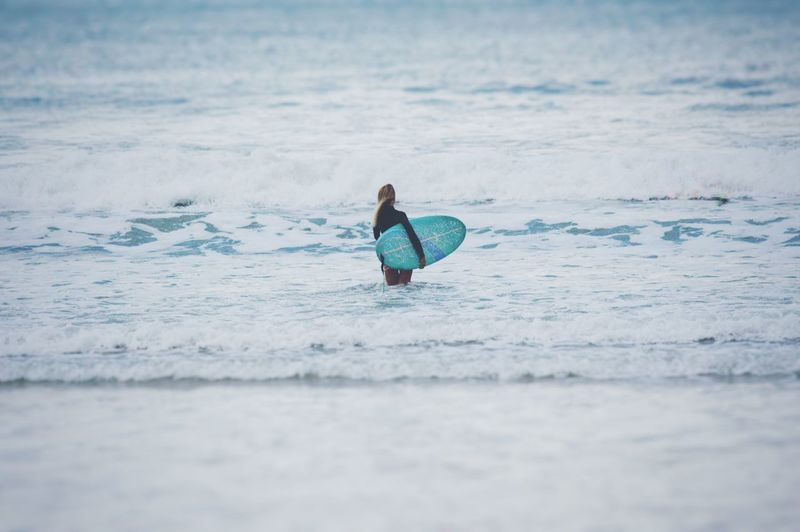 Full length of man surfing in sea