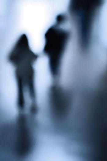 Defocused image of people walking on street