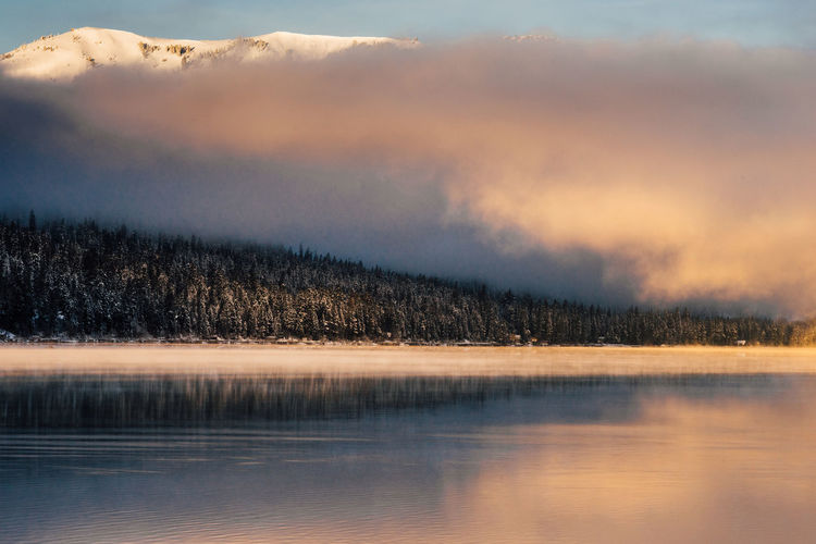 Winter sunrise at Donner Lake, California. California Donner Lake Truckee  Beauty In Nature Cloud - Sky Cold Temperature Day Fog Idyllic Lake Landscape Mountain Nature No People Outdoors Reflection Scenics Ski Sky Sunrise Sunset Tranquil Scene Tranquility Tree Water