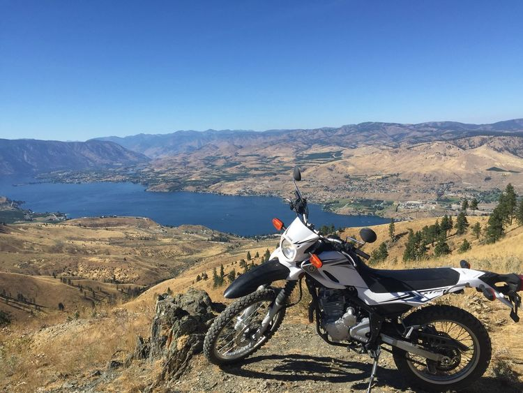 Mountain Motorcycle Transportation Land Vehicle Mode Of Transport Mountain Range Adventure Landscape Day Outdoors Clear Sky Nature Biker Beauty In Nature Motocross Backcountry Trail Trail Ride Trail Riding Yamaha XT 250 Lake Lake View Mountain View Mountains